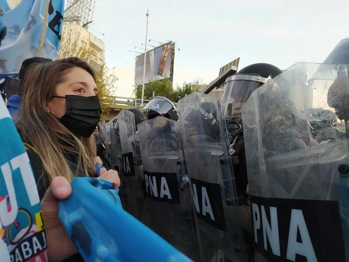 Manuela Castañeira in front of the police shields during a protest.