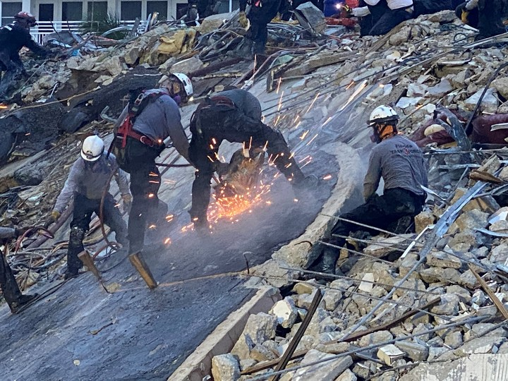 Rescuers must work to remove debris in search of survivors.  Photo REUTERS