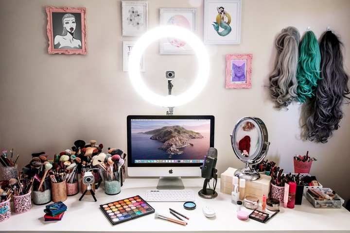 Light rings are an inexpensive alternative.  You can surround the webcam.  Photo Logitech