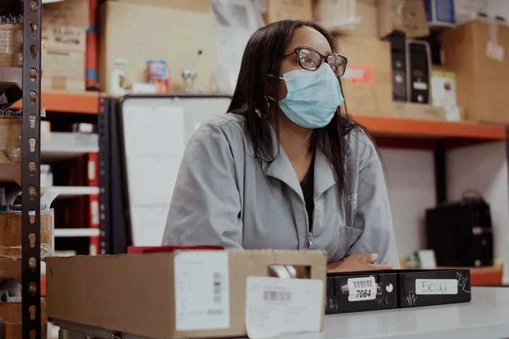 Tiara Felix, a lab worker at Metro Optics, said she is skeptical about getting vaccinated.  Photo: Laila Stevens / The New York Times