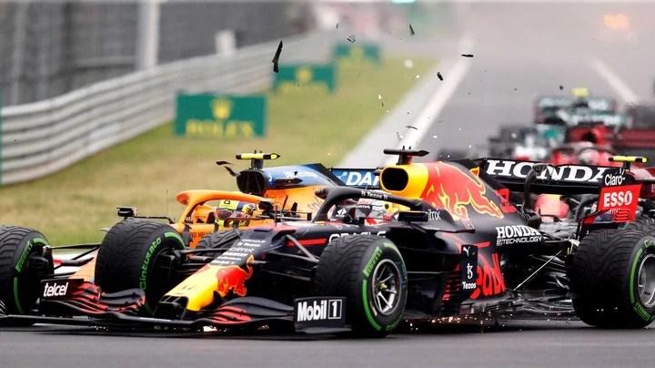 Lando Norris's McLaren collides with Max Verstappen's Red Bull at the Hungaroring.