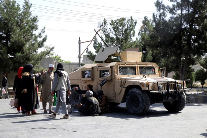 Taliban fighters control the outskirts of Kabul airport on Friday.  Photo: AP