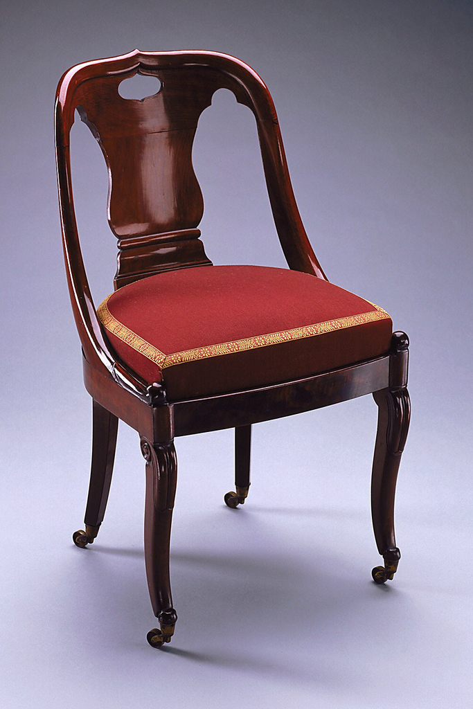 Object ID: 18312467 Accession Number: 1926-22-491 Acquired: 1926 Short URL: http://cprhw.tt/o/2BREc/ Side Chair, ca. 1840. Mahogany veneered oak and ash (frame), solid mahogany (legs, arms, and back), brass (coasters). Bequest of Mrs. John Innes Kane. 1926-22-491.