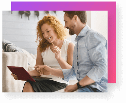 Selling Points - woman and man sitting and smiling at laptop