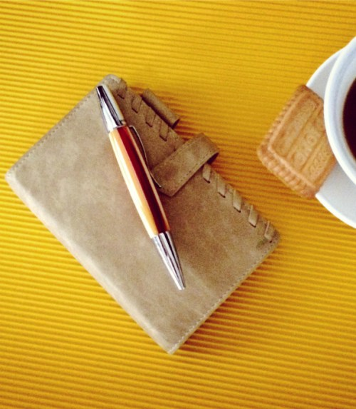 notebook-and-coffee-yellow-background
