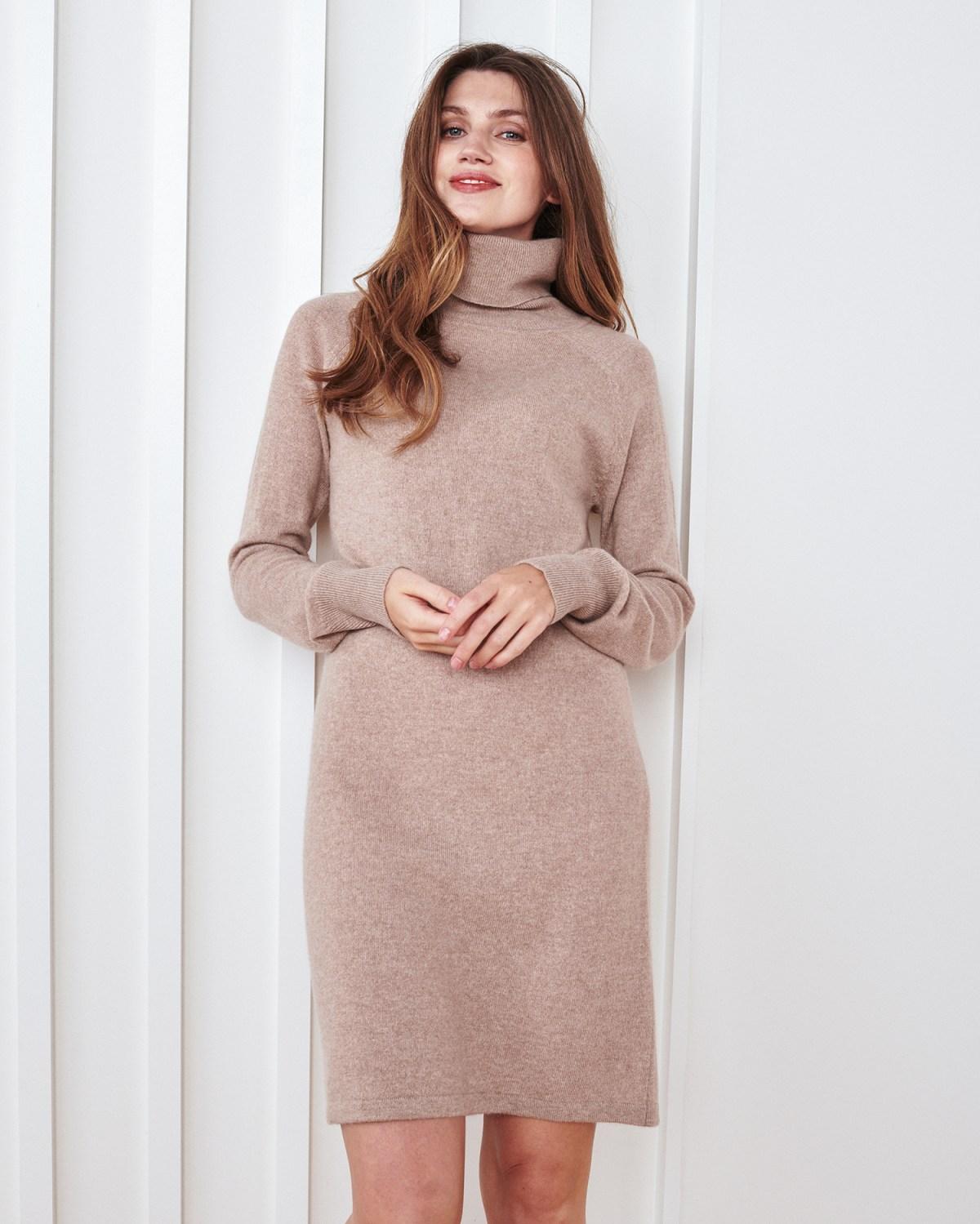 Woman wearing cashmere turtleneck sweater dress
