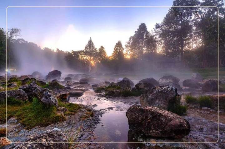 mist rises off a rock formation at Hot Springs National Park, a dog-friendly national park where one can go hiking with dogs