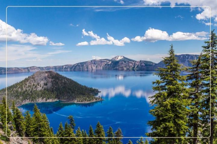clear skies and blue waters shine at Crater Lake National Park, a dog-friendly national park where one can go hiking with dogs