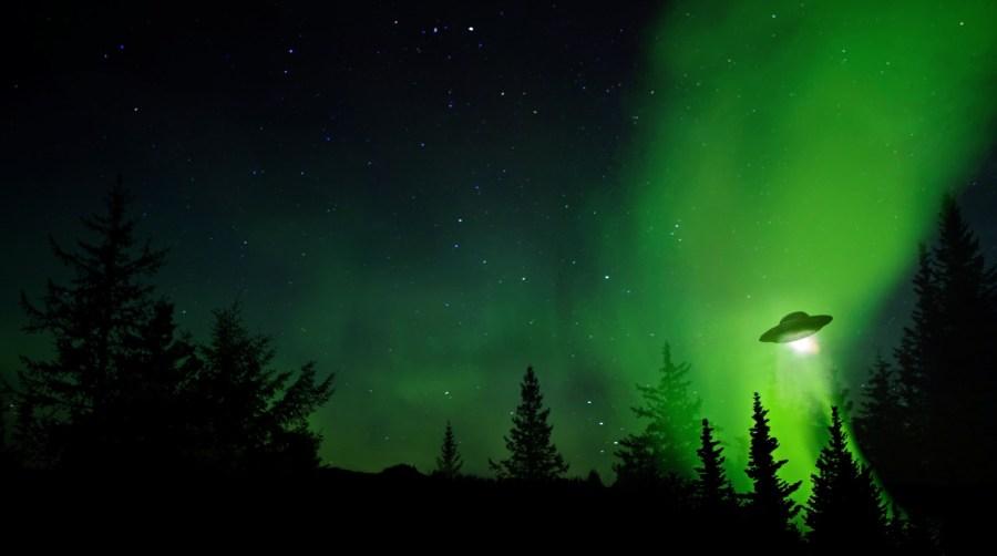 UFO flies amist an errie green sky