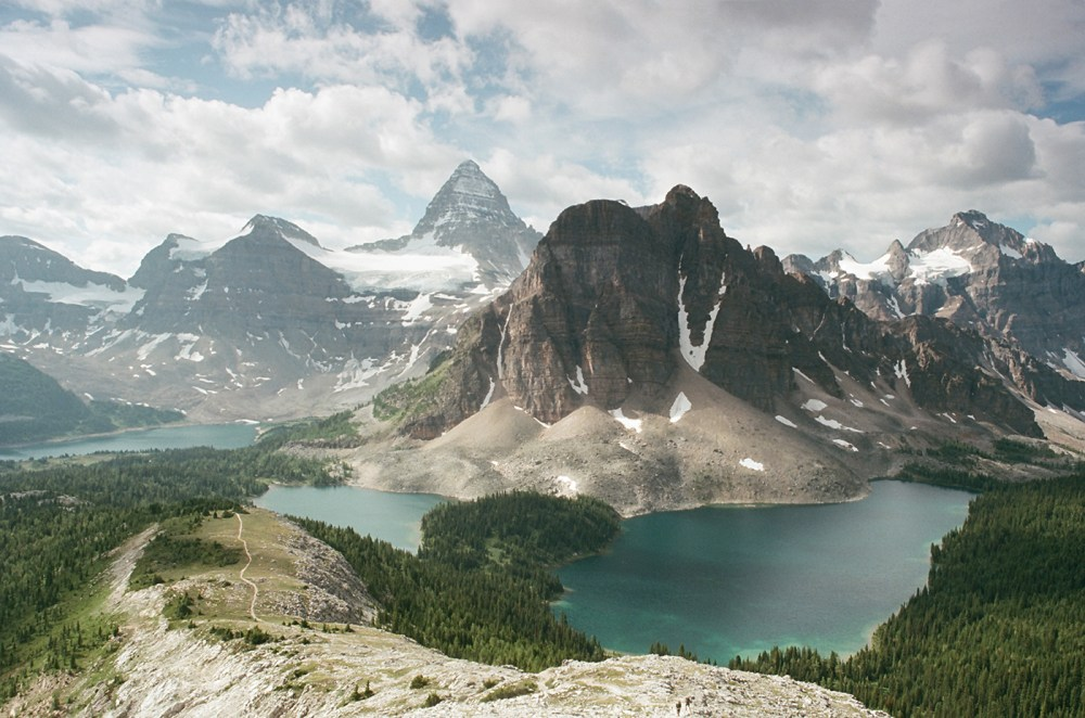 From mount assiniboine, 'matterhorn of the rockies', vast alpine meadows stretch far to the north interspersed with forested valleys and rocky peaks. Local S Guide To Backpacking Mount Assiniboine Bc Field Mag