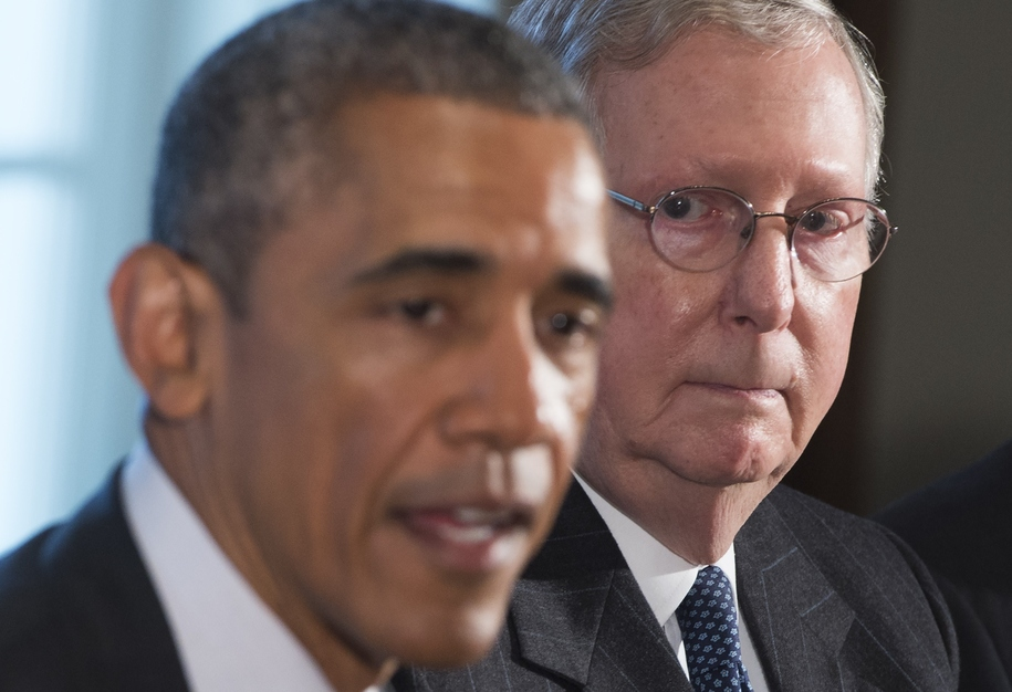 US President Barack Obama speaks alongside Senate Majority Leader Mitch McConnell (R), Republican of Kentucky, prior to a meeting of the bipartisan, bicameral leadership of Congress in the Cabinet Room at the White House in Washington, DC, January 13, 201