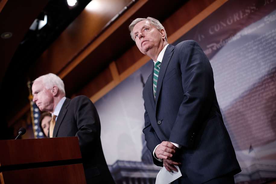 WASHINGTON, DC - MARCH 26: U.S. Sen. Lindsey Graham (R) (R-SC) listens as U.S. Sen. John McCain speaks on the recent bombings by Saudi Arabia in Yemen during a press conference on Capitol Hill March 26, 2015 in Washington, DC. During his remarks Graham s