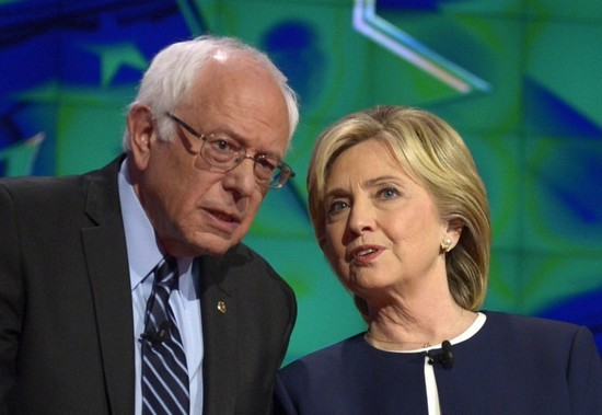 Democratic Presidential candidates Bernie Sanders (L) and Hillary Clinton (R) talk to each other on stage prior to the start of the Democratic presidential candidates debate at Wynn Las Vegas in Las Vegas, Nevada, USA, 13 October 2015.