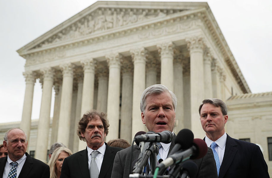 WASHINGTON, DC - APRIL 27:  Former Virginia Governor Robert McDonnell (2nd R) speaks to members of the media in front of the U.S. Supreme Court April 27, 2016 in Washington, DC. The Supreme Court heard the corruption appeal from McDonnell, who and his wife were convicted of accepting more than $175,000 of gifts and favors from businessman Jonnie Williams, who wanted their help to promote his dietary supplement product called Anatabloc.  (Photo by Alex Wong/Getty Images)