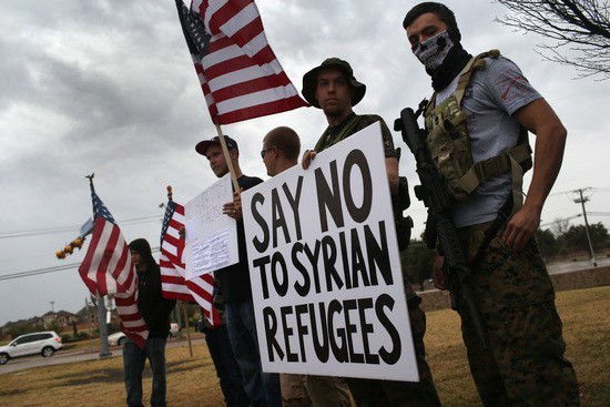 RICHARDSON, TX - DECEMBER 12: Armed protesters from the so-called Bureau of American-Islamic Relations (BAIR), take part in a demonstration in front of a mosque on December 12, 2015 in Richardson, Texas. About two dozen members of the group protested in front of the Islamic Association of North Texas mosque, as counter-protesters demonstrated across the street. The Dallas area had become a focal point for so-called Islamophobia, even before the Islamic extremist-inspired December 2 mass shooting in San Bernadino, California. (Photo by John Moore/Getty Images)