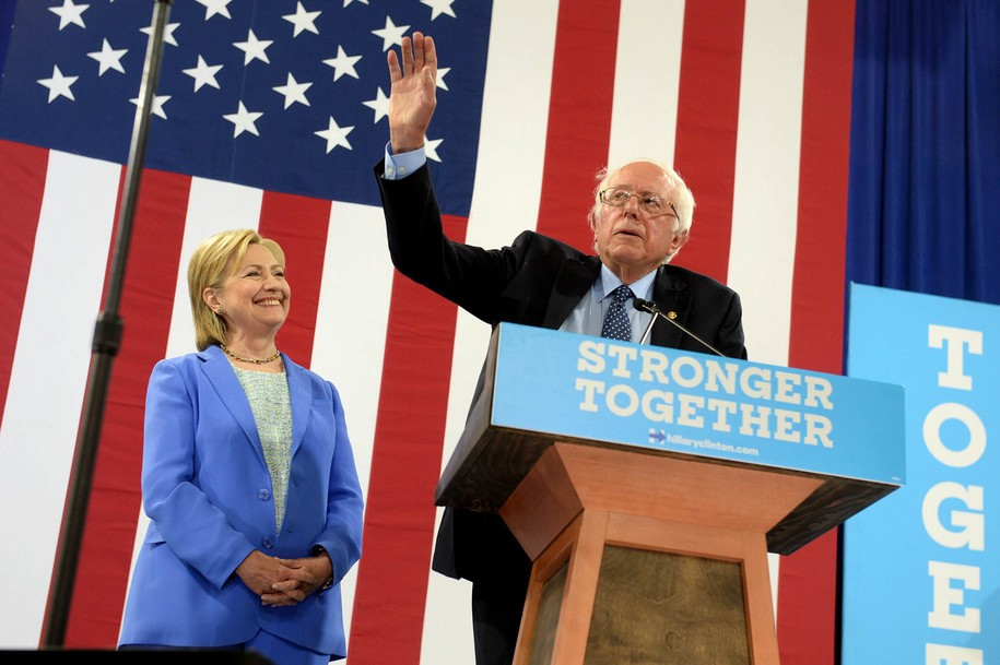 PORTSMOUTH, NH - JULY 12: Bernie Sanders (R) introduces Presumptive Democratic presidential nominee Hillary Clinton at Portsmouth High School July 12, 2016 in Portsmouth, New Hampshire. Sanders endorsed Clinton for president of the United States. (Photo by Darren McCollester/Getty Images)