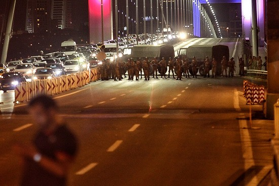 """ISTANBUL, TURKEY - JULY 15: Turkish soldiers block Istanbul's Bosphorus Bridge on July 15, 2016 in Istanbul, Turkey. Istanbul's bridges across the Bosphorus, the strait separating the European and Asian sides of the city, have been closed to traffic. Reports have suggested that a group within Turkey's military have attempted to overthrow the government. Security forces have been called in as Turkey's Prime Minister Binali Yildirim denounced an """"illegal action"""" by a military """"group"""", with bridges closed in Istanbul and aircraft flying low over the capital of Ankara. (Photo by Gokhan Tan/Getty Images)"""