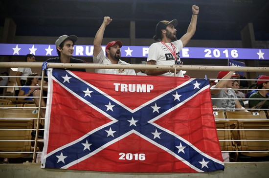 (L-R)Brandon Miles, Brandon Partin and Michael Miles cheer before Republican U.S. presidential nominee Donald Trump attends a campaign rally at the Silver Spurs Arena in Kissimmee, Florida August 11, 2016. REUTERS/Eric Thayer - RTSMSW0