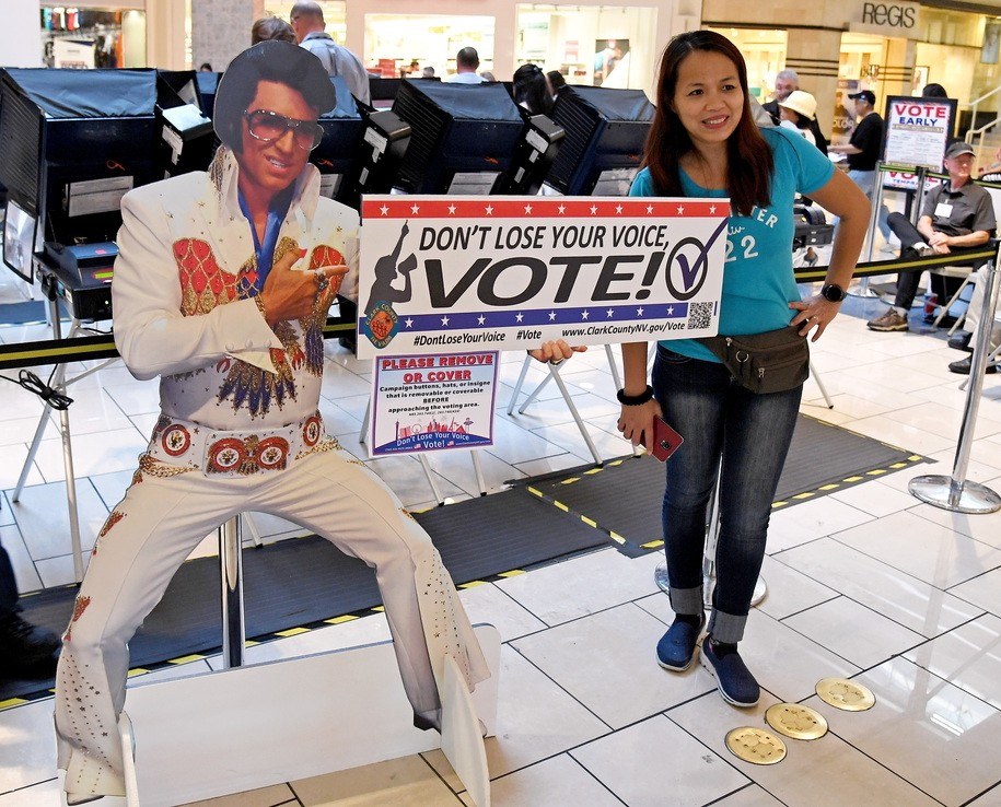 LAS VEGAS, NV - OCTOBER 26:  First-time voter Jeanne Marquez of Nevada poses next to an Elvis Presley-themed cardboard cutout before voting early at the Meadows Mall on October 26, 2016 in Las Vegas, Nevada. Voters in Clark County are voting early at a record pace in this election ahead of the November 8 general election.  (Photo by Ethan Miller/Getty Images)