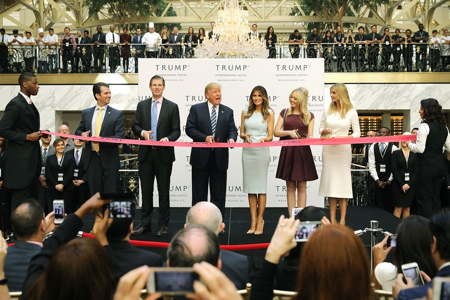 WASHINGTON, DC - OCTOBER 26:  Republican presidential nominee Donald Trump (C) and his family (L-R) son Donald Trump Jr, son Eric Trummp, wife Melania Trump and daughters Tiffany Trump and Ivanka Trump cut the ribbon at the new Trump International Hotel October 26, 2016 in Washington, DC. The hotel, built inside the historic Old Post Office, has 263 luxry rooms, including the 6,300-square-foot 'Trump Townhouse' at $100,000 a night, with a five-night minimum. The Trump Organization was granted a 60-year lease to the historic building by the federal government before the billionaire New York real estate mogul announced his intent to run for president.  (Photo by Chip Somodevilla/Getty Images)