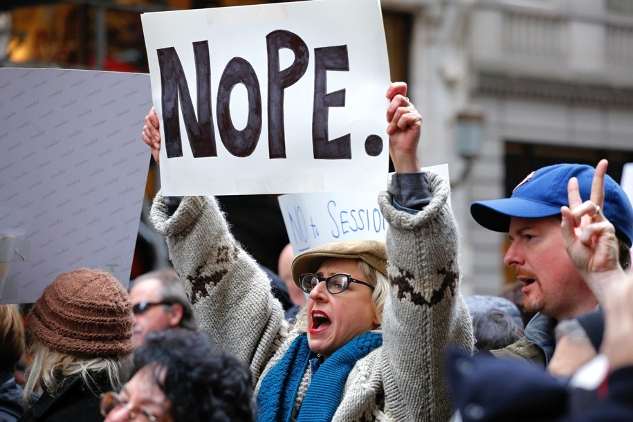 A woman protests against US President-elect Donald Trump in front of Trump Tower on November 20, 2016 in New York. / AFP / KENA BETANCUR        (Photo credit should read KENA BETANCUR/AFP/Getty Images)