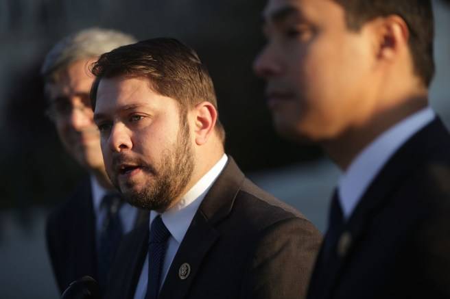 """WASHINGTON, DC - DECEMBER 08: U.S. Rep. Ruben Gallego (D-AZ) (2nd L) speaks as Rep. Joaquin Castro (D-TX) (R) and Mexican American Legal Defense and Education Fund President and General Counsel Thomas Saenz (L) listen during a news conference in front of the Supreme Court December 8, 2015 in Washington, DC. The Congressional Hispanic Caucus held the news conference on the day the Supreme Court hears oral arguments on Evenwel v. Abbott, """"on whether voting districts should continue to be drawn by using census population data, which include noncitizen immigrants, or whether the system should be changed to count only citizens eligible to vote, as conservative challengers are seeking."""" (Photo by Alex Wong/Getty Images)"""