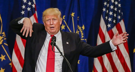 epa05287600 Businessman and Republican presidential candidate Donald Trump gestures as he speaks at a campaign rally at the Century Center in South Bend, Indiana, USA, 02 May 2016. Indiana voters go to the polls for the winner take all Indiana primary election on 03 May.  EPA/TANNEN MAURY
