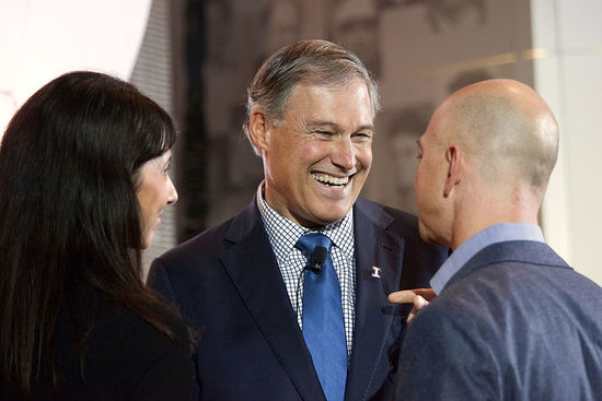 SEATTLE, WA - OCTOBER 11: Washington Governor Jay Inslee (C) speaks with Amazon.com founder and CEO Jeff Bezos (R) and his wife MacKenzie Bezos during a launch event for the Bezos Center for Innovation at the Museum of History and Industry on October 11, 2013 in Seattle, Washington. Supported by Jeff and MacKenzie Bezos, the center aims to highlight the history and future of innovation in the Puget Sound region. (Photo by David Ryder/Getty Images)