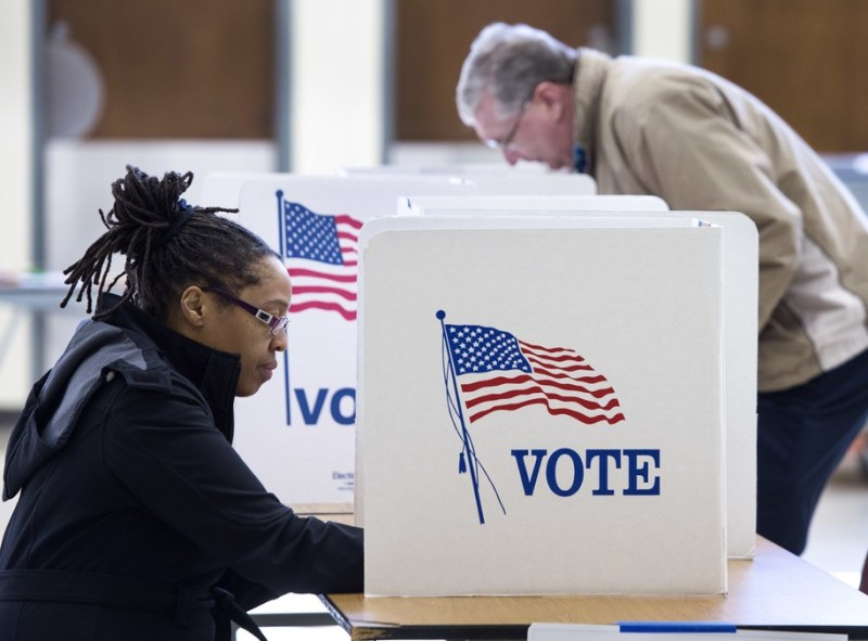 """People vote in the Super Tuesday primary at Centreville High School March 1, 2016, in Centreville, Virginia..Voters in a dozen states will take part in """"Super Tuesday"""" -- a series of primaries and caucuses in states ranging from Alaska to Virginia, with Virginia the first to open its polling stations at 6:00 am (1100 GMT). / AFP / PAUL J. RICHARDS (Photo credit should read PAUL J. RICHARDS/AFP/Getty Images)"""