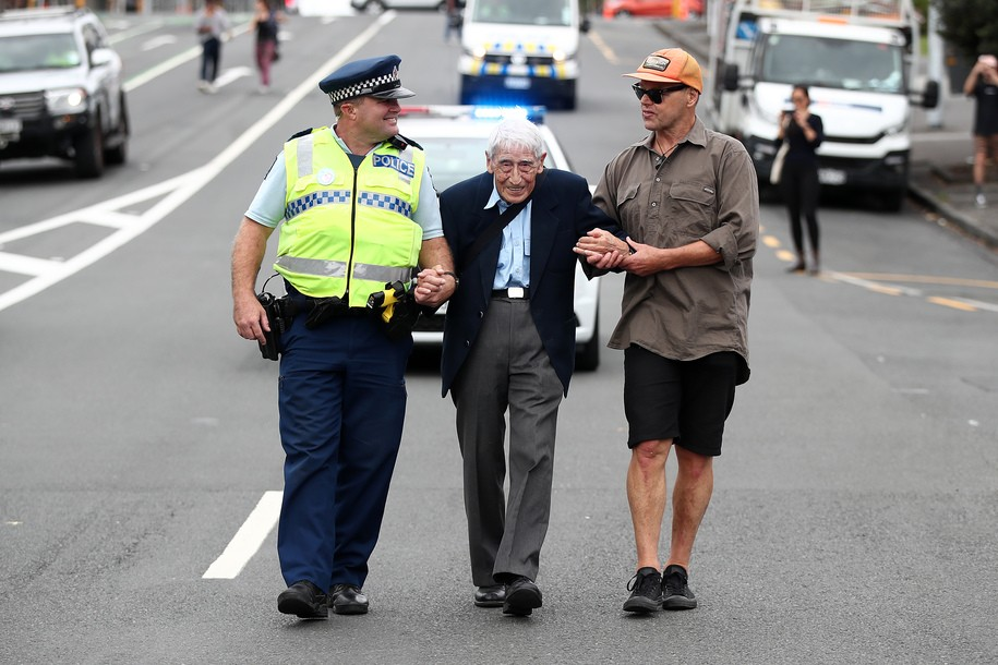 AUCKLAND, NEW ZEALAND - MARCH 24: John Sato (C) 95, one of only two Japaenses servicemen in the New Zealand army in WWII, took two buses from Howick to join the march against racism at Aotea Square on March 24, 2019 in Auckland, New Zealand. 50 people were killed, and dozens were injured in Christchurch on Friday, March 15 when a gunman opened fire at the Al Noor and Linwood mosques. The attack is the worst mass shooting in New Zealand's history. (Photo by Fiona Goodall/Getty Images)