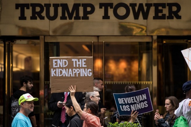 NEW YORK, NY - JULY 25: Activists rally and call on the Trump administration to meet tomorrow's court ordered deadline to return immigrant children to their families after being separated at the southern border, outside Trump Tower in Midtown Manhattan, July 25, 2018 in New York City. A federal judge ordered a July 26 deadline for the U.S. government to reunite over 2,000 migrant children ages 5 to 17 that had been separated from their families. (Photo by Drew Angerer/Getty Images)