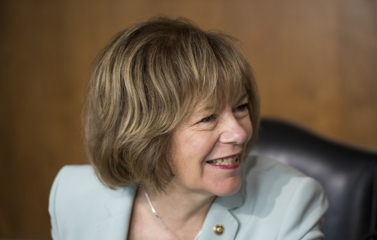 UNITED STATES - AUGUST 16: Sen. Tina Smith, D-Minn., chats with a fellow senator before the start of the Senate Energy and Natural Resources Committee hearing on Thursday, Aug. 16, 2018. (Photo By Bill Clark/CQ Roll Call)