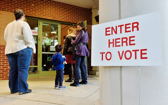 DURHAM, N.C - NOVEMBER 8:  A voting line trails outside of a precinct as voters wait to get in on November 8, 2016 in Durham, North Carolina.  Precincts are expected to be crowded across the battleground state. Citizens of the United States will choose between Republican presidential candidate Donald Trump and Democratic presidential candidate Hillary Clinton as they pick their choice for the next president of the United States. (Photo by Sara D. Davis/Getty Images)