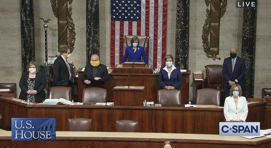 Screenshot of House staff wearing masks on House floor.