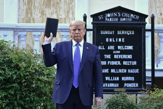 US President Donald Trump holds up a Bible outside of St John's Episcopal church across Lafayette Park in Washington, DC on June 1, 2020. - US President Donald Trump was due to make a televised address to the nation on Monday after days of anti-racism protests against police brutality that have erupted into violence..The White House announced that the president would make remarks imminently after he has been criticized for not publicly addressing in the crisis in recent days. (Photo by Brendan Smialowski / AFP) (Photo by BRENDAN SMIALOWSKI/AFP via Getty Images)