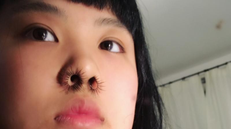 Nose hair extensions are the latest beauty trend. (Photo: Instagram / gret_chen_che)
