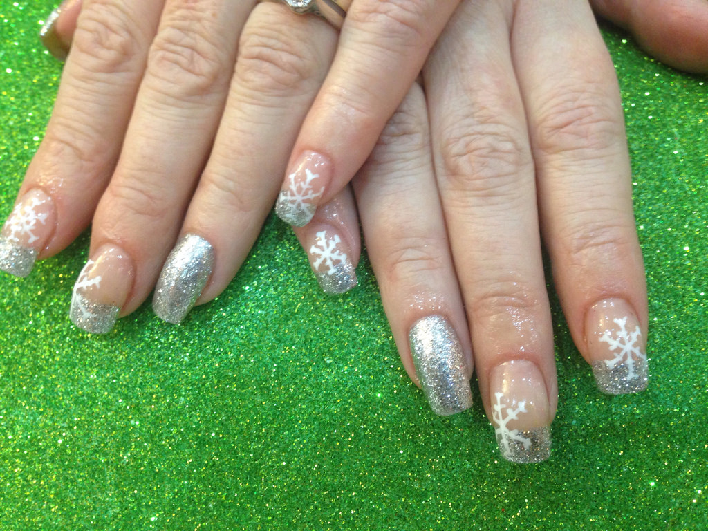 White Snowflake Art On Silver Nail