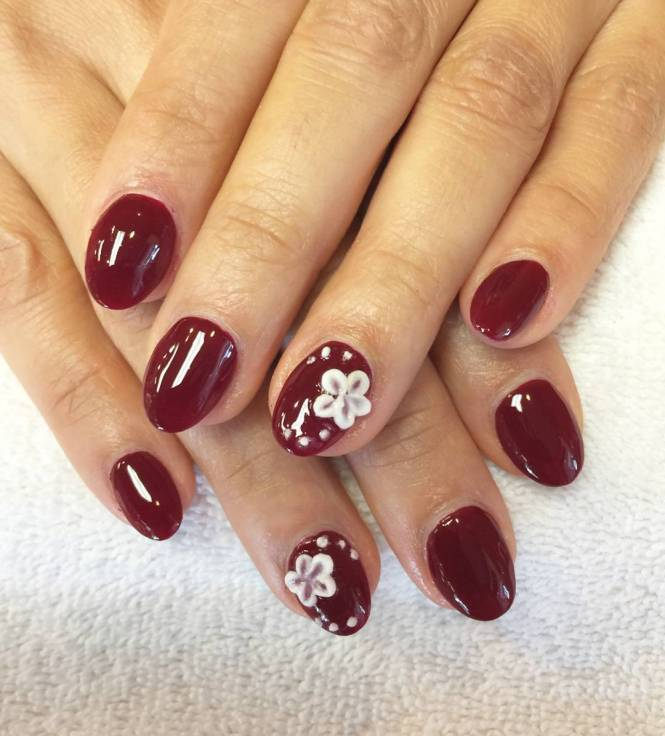 Edgy Dark Red Nails With Skulls