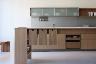 Viola Park ranks high on the list of great, modern kitchen systems and offers a range of kitchen islands. Among the features in their islands is the Pivot Storage System, shown here. Mounted below the counter to preserve counter space, the wood bins can be outfitted as knife block, utensil holder, or garbage bin. The system conveniently keeps your utensils where you need them, without taking up much-valued counter space.