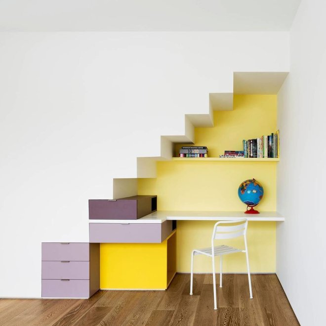 10 Smart and Surprising Under-Stair Design Solutions - Photo 1 of 10 - In this home by O'Neill Rose Architects in Queens, New York, three generations of a family were living in a single house, including a young girl. To provide a space for her to complete her schoolwork, the architects designed this bright, energetic desk area under the stairs, but managed to make the space feel like anything but an afterthought.