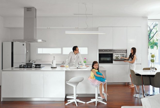 These 30 White Kitchens Are Anything But Ordinary - Photo 20 of 30 - For the kitchen, architect Ivan Priatman selected an oven, hood, and cooktop from Teka and a Samsung refrigerator. While the table is his own design, the bar stools and chairs are from Informa.