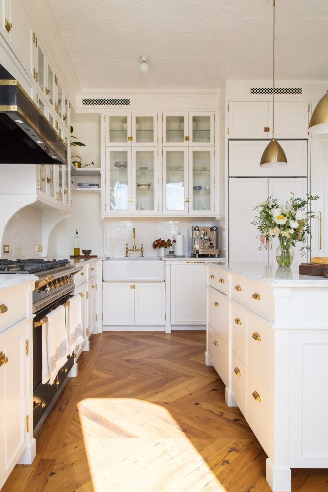 "These 30 White Kitchens Are Anything But Ordinary - Photo 6 of 30 - ""There's a nice tension that exists in this renovation. The building has exquisite original architectural details, and we kept the delicacy of that detailing at the front of our minds as we designed—allowing it to serve as our inspiration for the slender proportions that prevail in the kitchen and the dressing room millwork. We added arched elements on the existing windows. Additionally, an extra arched framing device that springs from corbels acts as a divider between the kitchen and dining room,"" explains Kevin Greenberg of Space Exploration."