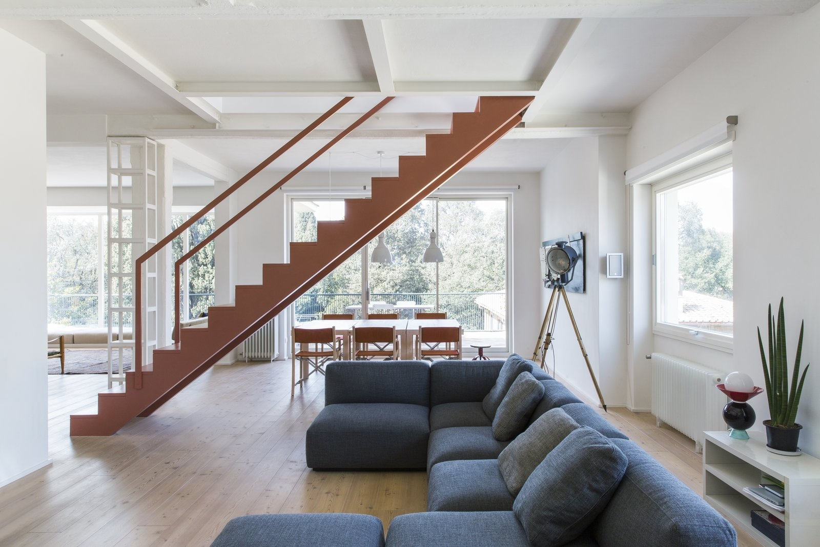 A Pink Staircase Dominates The Revival Of This Roman Apartment Dwell | Stairs In Middle Of Room Interior Design | 3 Story Staircase | House | Middle Hallway | Private Home | Mixed Interior