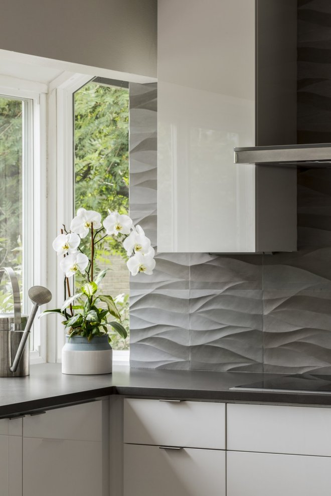 25 Backsplash Ideas For Your Kitchen Renovation - Photo 19 of 25 - Detail of natural stone backsplash by Decorative Materials Inc. High gloss white cabinets by Vogo.