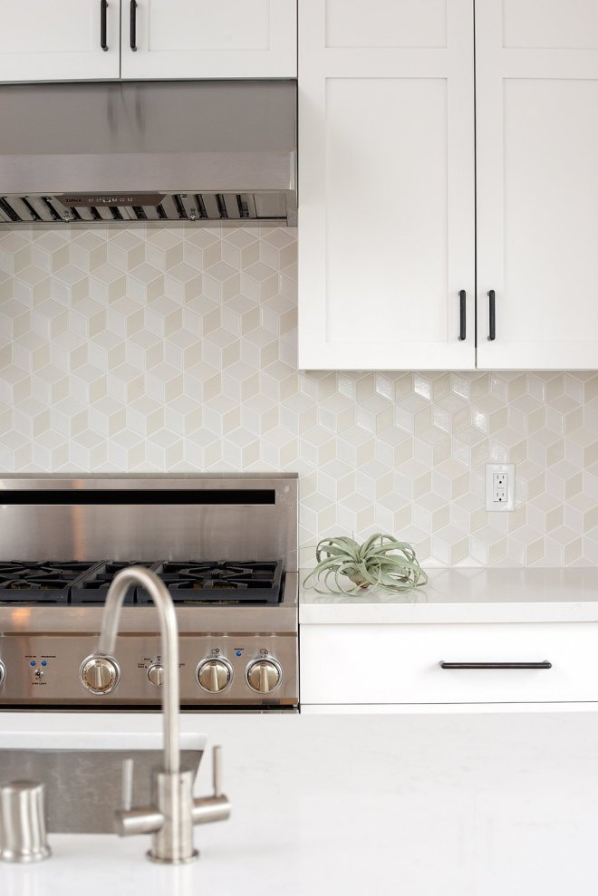 25 Backsplash Ideas For Your Kitchen Renovation - Photo 16 of 25 - Fresh white kitchen with warm wood wrapped island, black cabinet pulls and Dwell patterns Heath tile backsplash .
