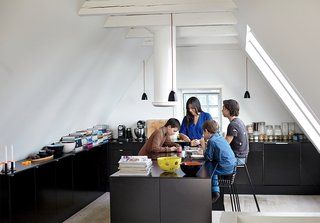 Kitchen, Pendant Lighting, and Ceiling Lighting With three sons in the family, the kitchen gets a lot of use. Hee barstools by Hee Welling for Hay slide up to a multi-functioning island where the family gathers to eat, study and play.
