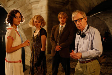 "Marion Cotillard, Alison Pill, Owen Wilson and Director Woody Allen on the set of ""Midnight in Paris."""