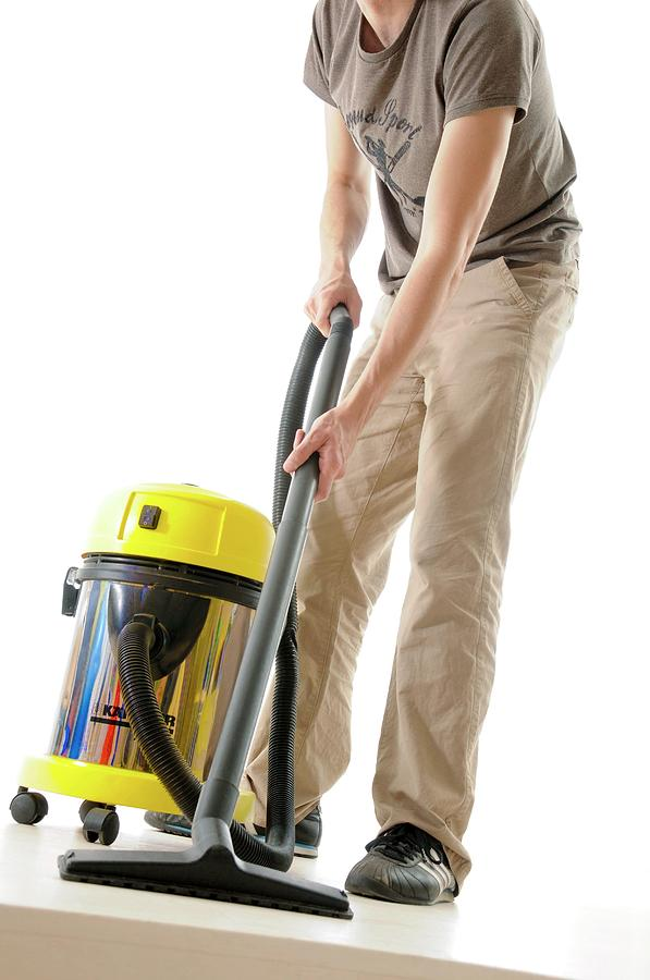 vacuum cleaning by aj photo science photo library