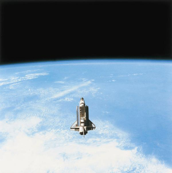 Aerial View Of The Space Shuttle In Orbit Above Earth