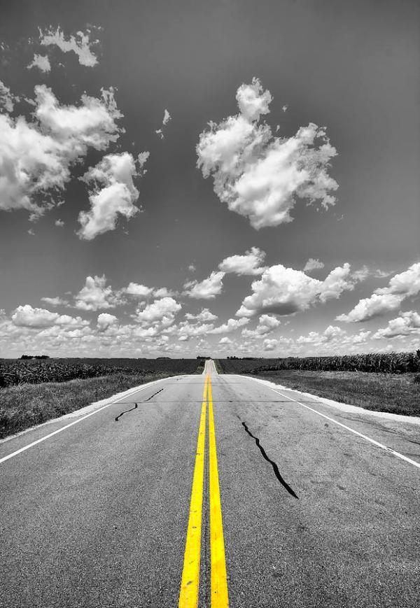Down A Black And White Road Photograph by Bill Tiepelman